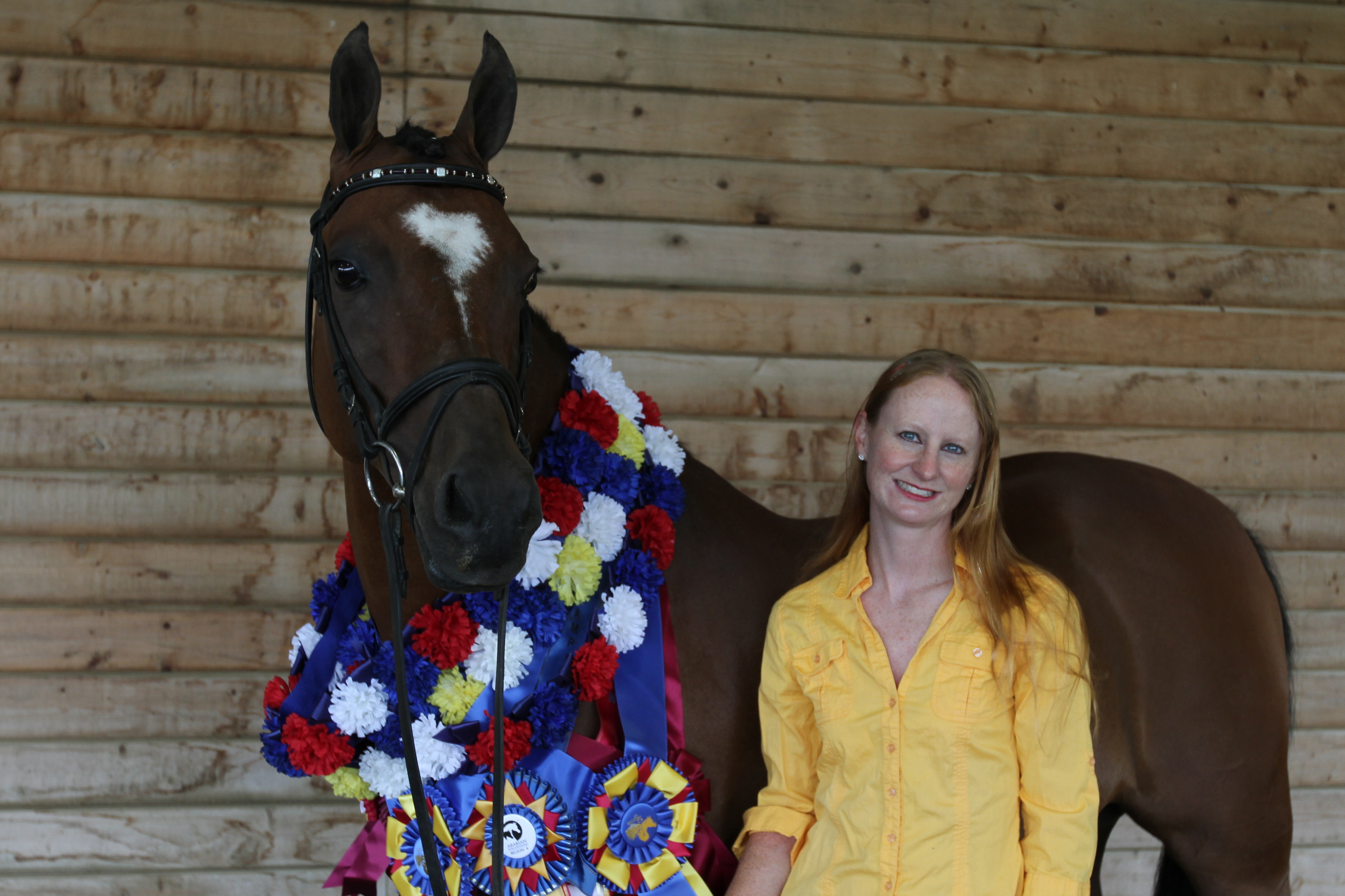 Kim and multi-champion  FEI gelding Sunday with some of their awards.
