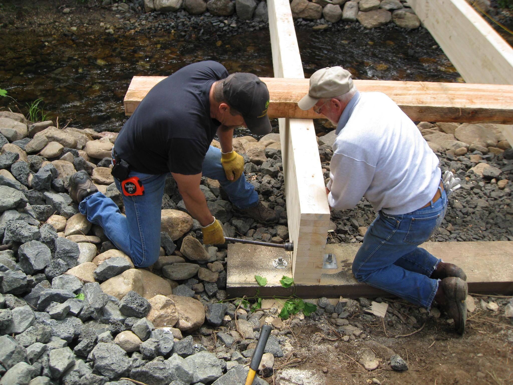 Building a bridge at Liberty Lake County Park