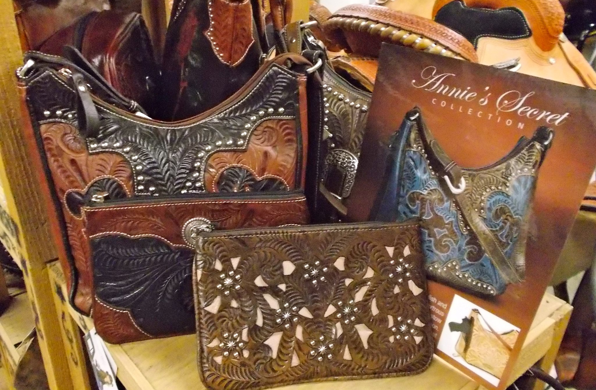 You will also find genuine leather purses and a complete line of men's, women's and kids belts.  Not to mention we have a large selection of home decor items like dishes, mugs, towels and more.