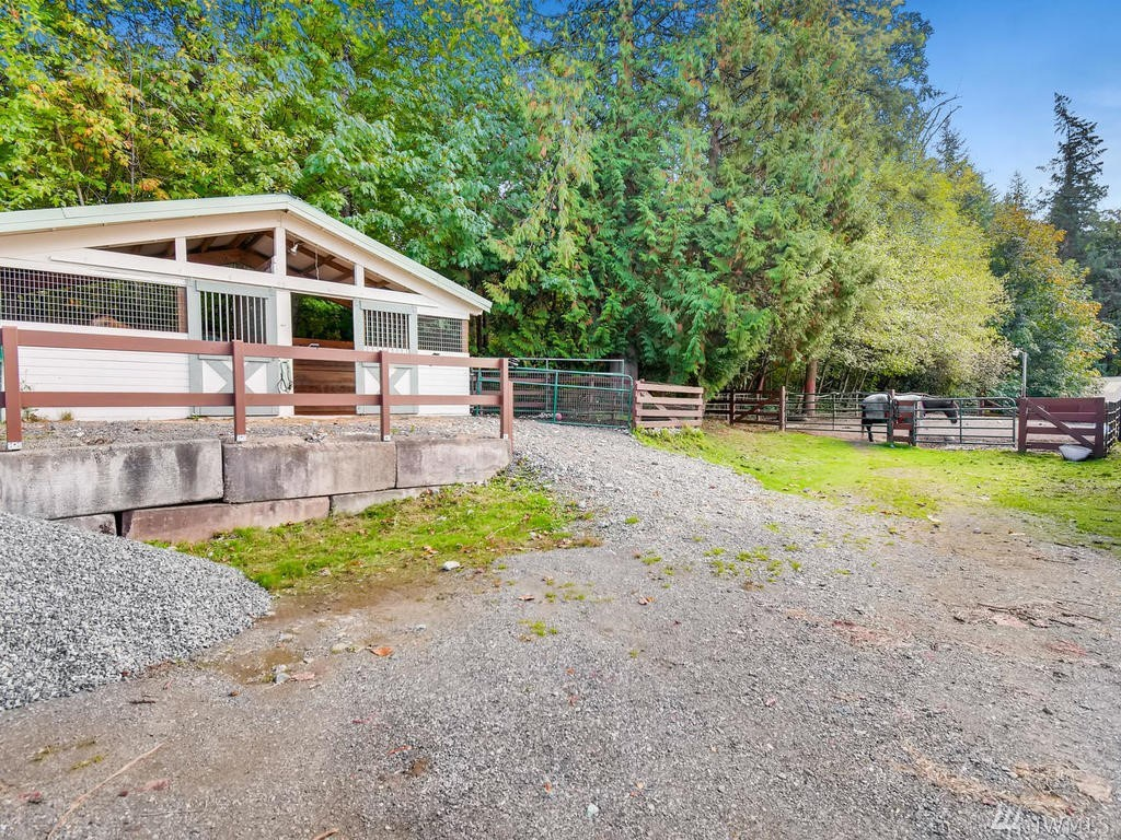 Separate small barn with two stalls opening into individual  paddocks.