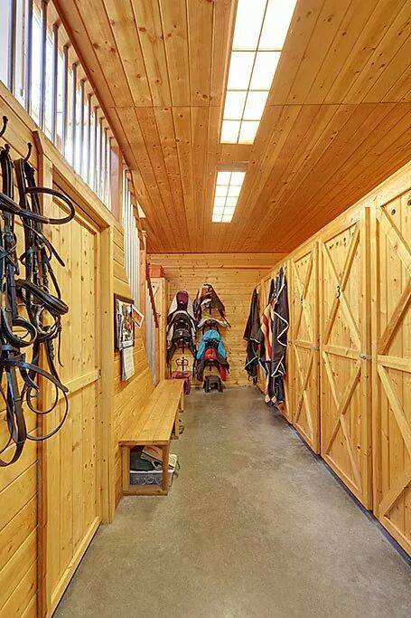 Personal tack lockers along with a handy bench.