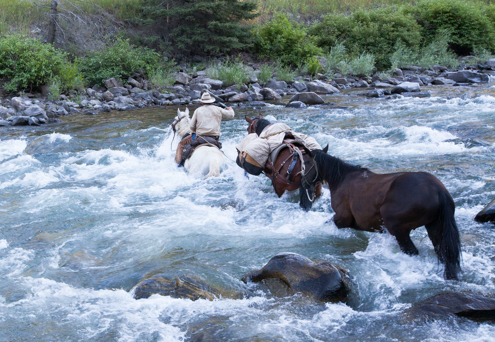There was a cliff face on one side of the river and a highway on the other. We had no choice but to ride straight upstream…
