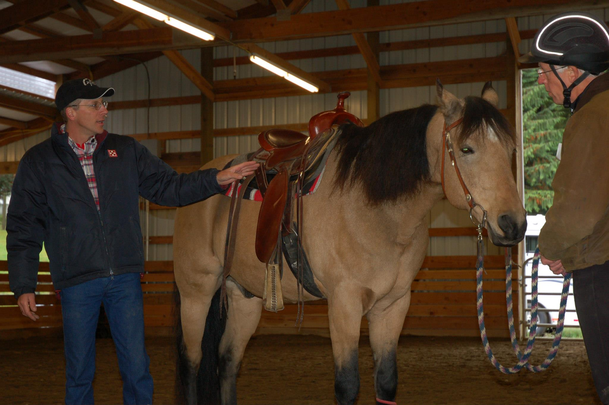 Rick Brighton discussing the importance of a saddle that fits. At Triple J Ranch in Issaquah.
