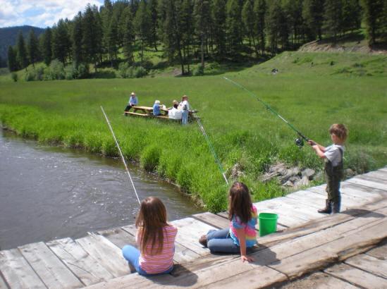 Kid fishing from the bridge.