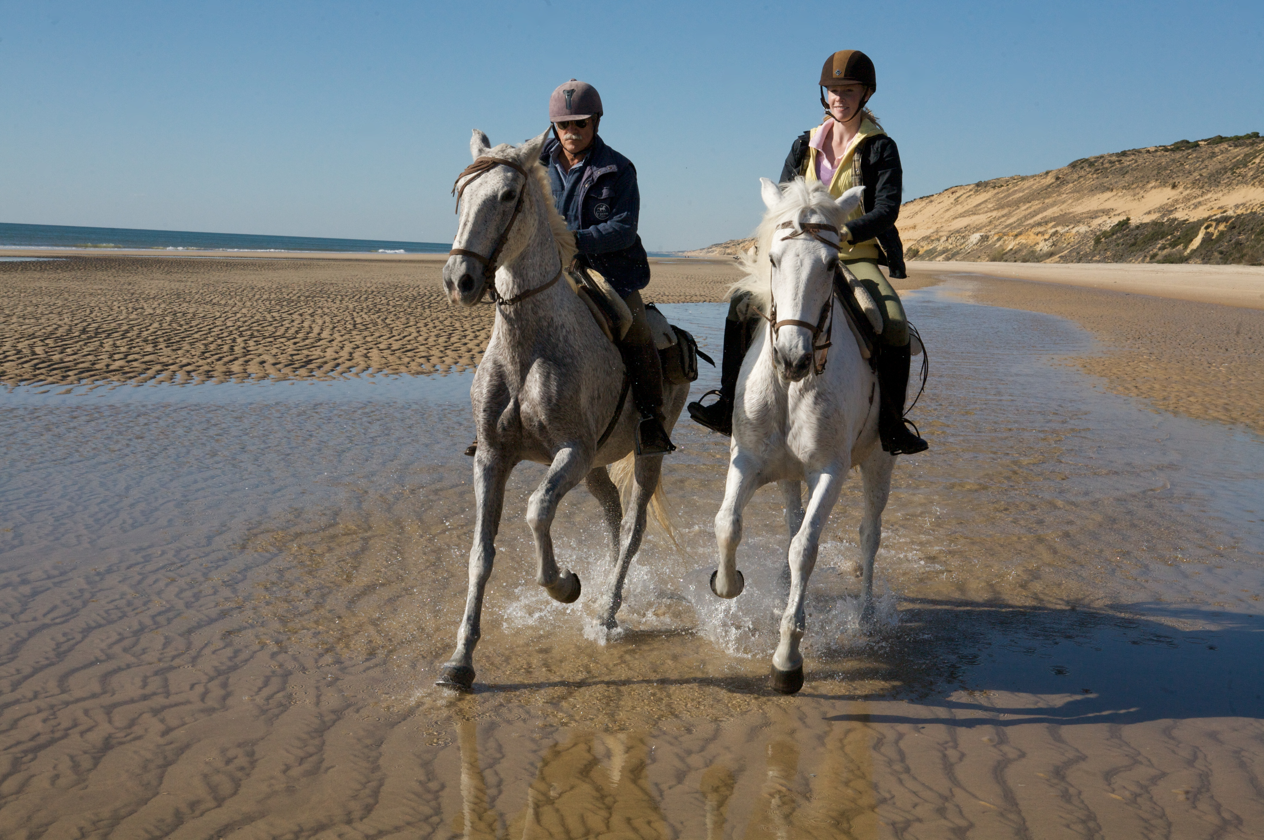 Fernando Garcia and Darley Newman canter the beaches of Donana National Park for the Equitrekking Southern Spain episode.