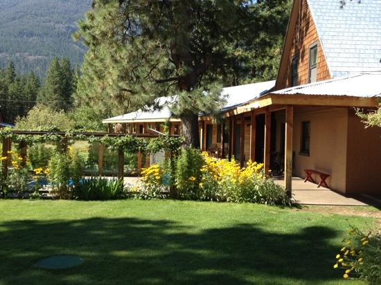 Main Ranch House – 5 bedroom house, 2 baths, living room, dining room, fully equipped kitchen, laundry room. Wrap around sun decks with furniture. Sleeps 13 people in beds.