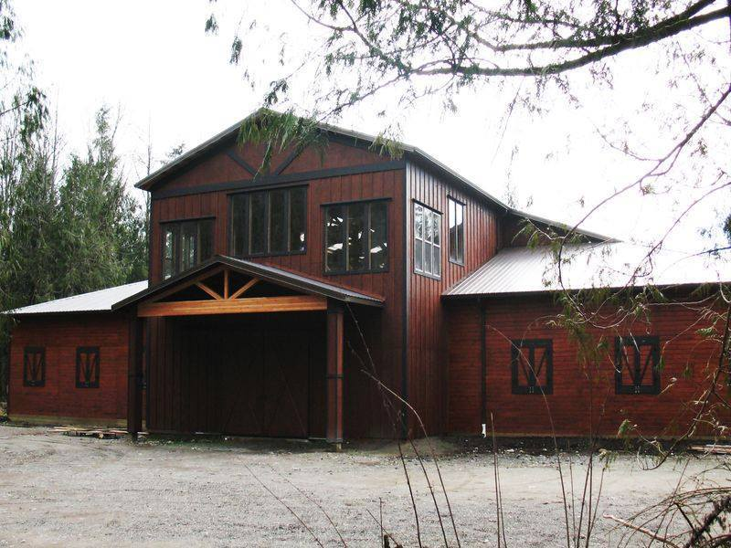 We built this equestrian facility (arena, stall, and barn) in Tulalip. The second floor was left unfinished, but the space could become an office, game room, or apartment.