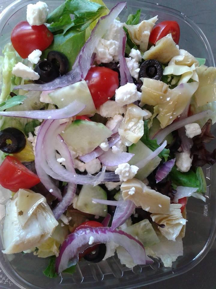 Greek Salad: Mixed Greens, Feta, Tomatoes, Artichoke hearts, Red Onion, Black Olives