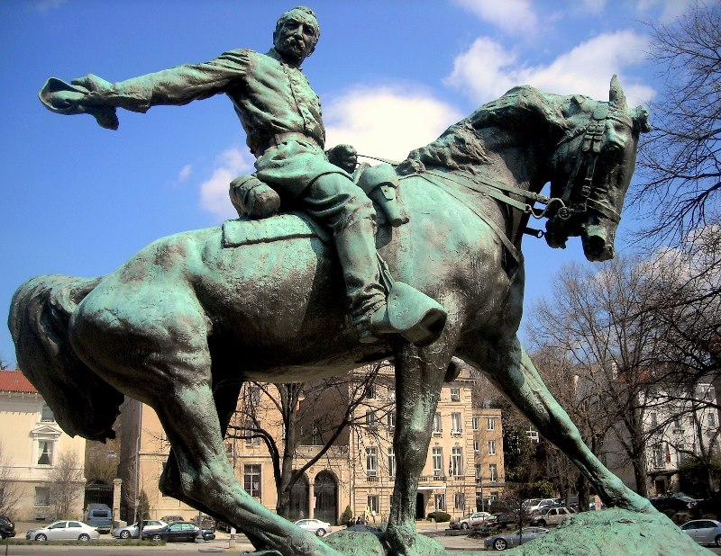 "A few tidbits about this statue: ""–most equestrian statues in Washington are atop pedestals forcing viewers to gaze at the underbelly, Sheridan and his horse, Rienzi, look as if they have come galloping down Massachusetts Ave sending dirt flying as they skid to a halt. Set low to the ground, Sheridan looks the viewer right in the eye. When the time came for a monument, Mrs. Sheridan made sure that the horse was as proud and courageous as its rider."""
