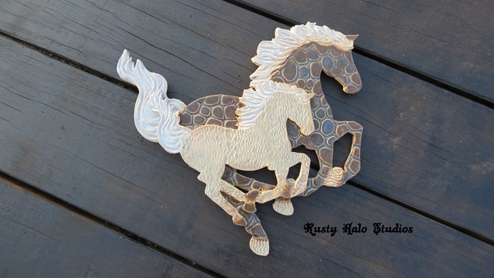 Floating Blue 9″ x 10″ Stoneware Mare and Foal. For use as a wall hanging.