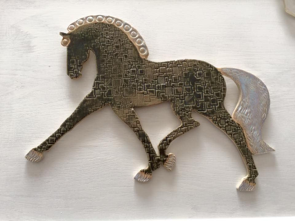 These are stoneware, so you can hang them inside or outside. The backs wired for hanging.  Dressage 13″ x 10″.
