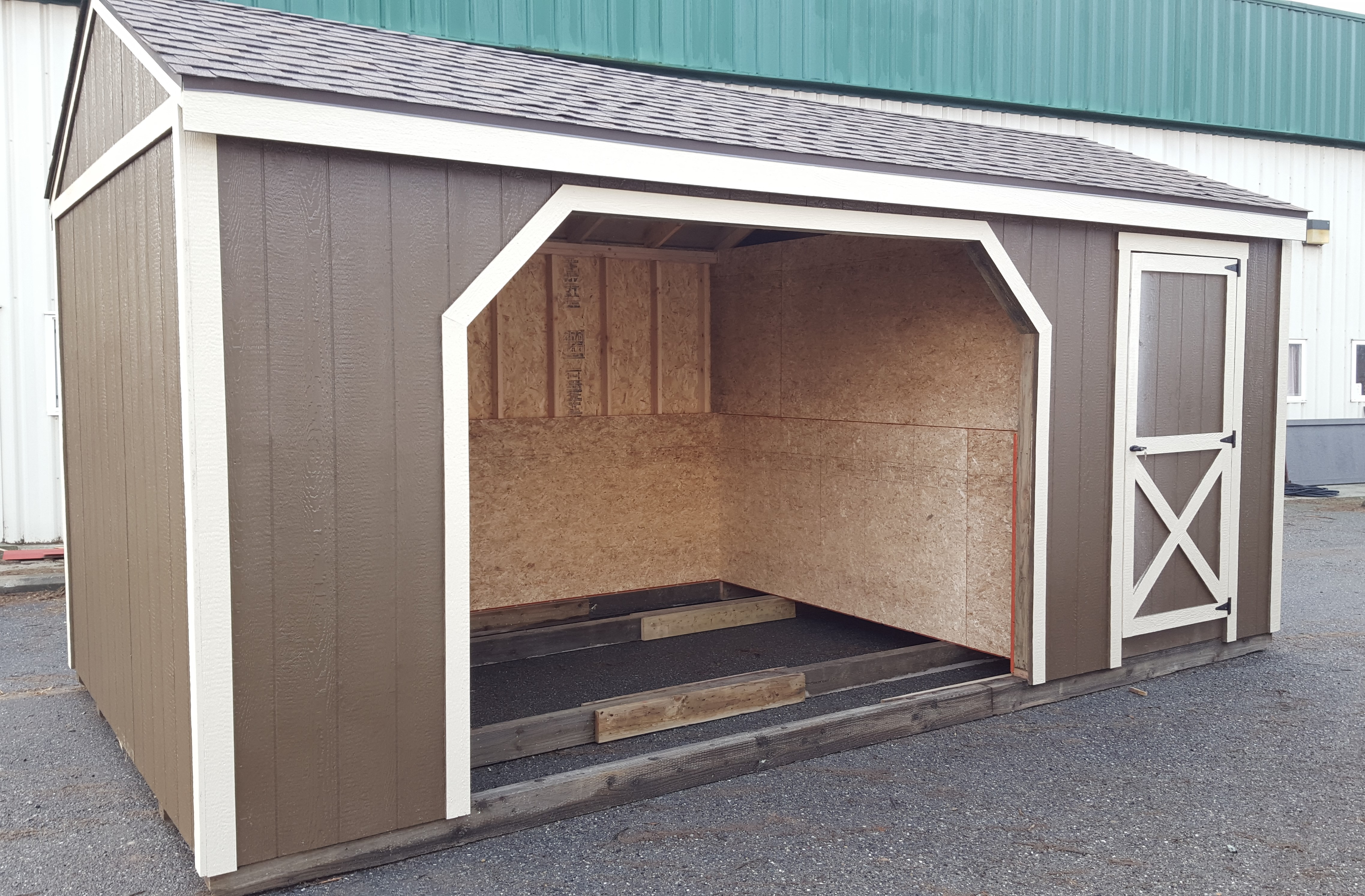 Run-in sheds have 8ft walls with interior walls lined up to 4ft. Offered in several sizes, 10×12, 10×16, 10×20, 10×24, 10×30, 10×32 and starting at $2160.  Tack or feed room addition for $450, we can even put in quick drop feed door.